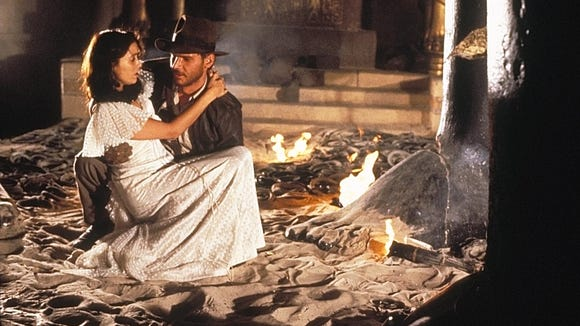 Indy (Harrison Ford) and Marion (Karen Allen) in a