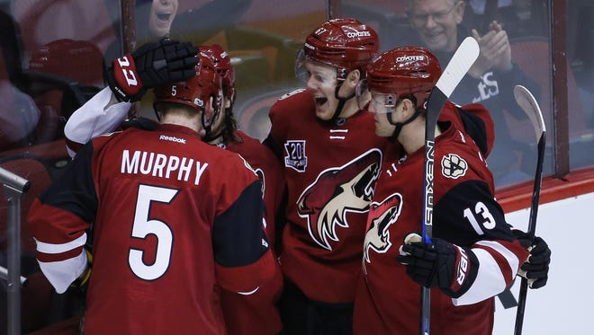 Coyotes' Ryan White (25) celebrates with Lawson Crouse (67) and Connor Murphy (5) after scoring in the second period at Gila River Arena on January 23, 2017 in Glendale, Ariz.