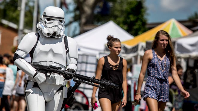 Ed Torre, of Midland, is dressed as a Storm Trooper during the Marine City International Comic Con Saturday, August 6, 2016 along South Water Street in Marine City.