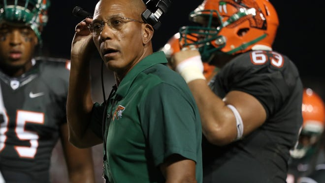 FAMU Head Coach Alex Wood talks to his team on the sidelines as they take on NC Central during their Thursday night game at Bragg Memorial Stadium.