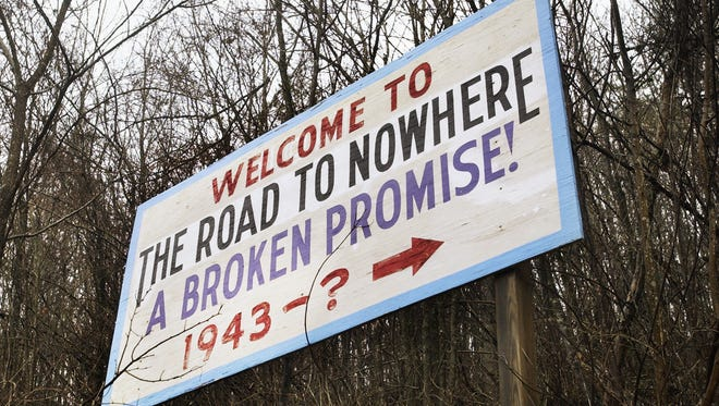"""Swain County residents wanting government action on the """"Road to Nowhere"""" years ago erected this sign along North Shore Road near Bryson City."""