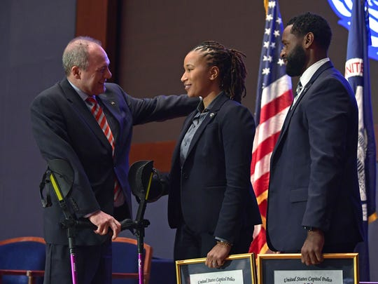 House Majority Whip Steve Scalise, R-La., greets Capitol Police special agent Crystal Griner as special agent David Bailey looks on during a Medal of Honor ceremony on Capitol Hill on Nov. 9, 2017.