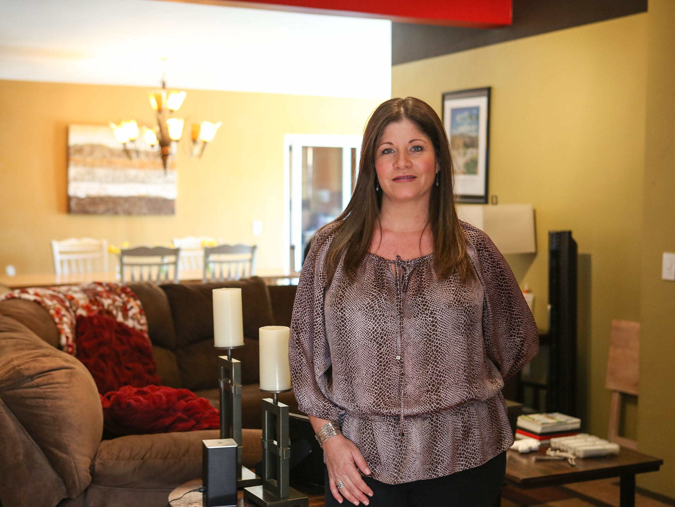 Dori Petee in a home she and her family rent in Desert