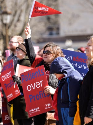 About 500 nurses, including Katie Scott of Ann Arbor, rally at the state Capitol on Wednesday afternoon, March 22, 2017.