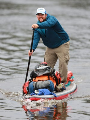 Jesse Hieb of Milwaukee is traveling the entire 430-mile length of the Wisconsin River this month on a stand-up paddle board loaded down with all his food, clothes and camping supplies.