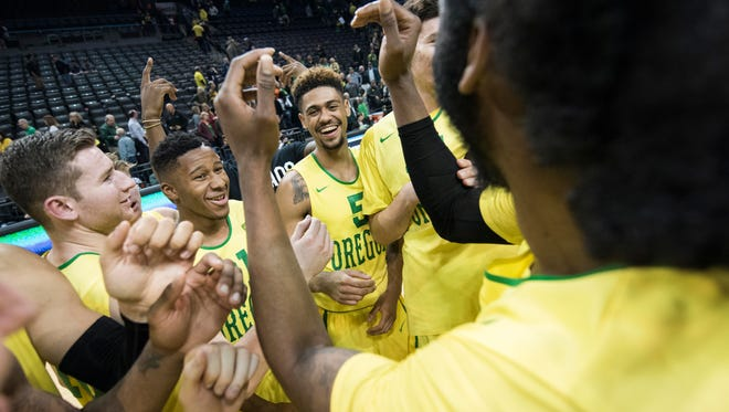 Feb 20, 2016; Eugene, OR, USA; University of Oregon Ducks guard Tyler Dorsey (5) celebrates with teammates after a game against the Oregon State University Beavers at Matthew Knight Arena. The Ducks beat the Beavers 91-81. Mandatory Credit: Troy Wayrynen-USA TODAY Sports