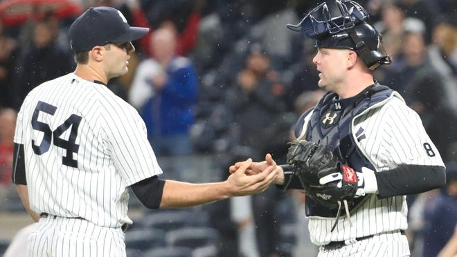 Yankees pitcher Richard Bleier shakes hands with catcher Brian McCann after a 5-1 win over the Boston Red Sox last September. Bleier was traded by the Yankees to the Baltimore Orioles last month.