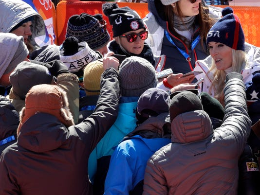United States' LindseyVonn talks to the media after her run in the women's super-G at the 2018 Winter Olympics in Jeongseon, South Korea, Saturday, Feb. 17, 2018. (AP Photo/Charlie Riedel)