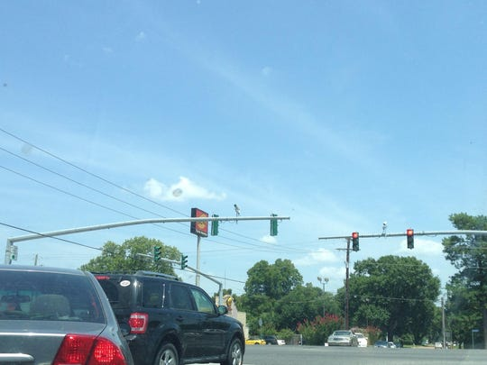 Traffic sensors are attached to poles on MacArthur Drive in Alexandria. The sensors detect the flow of traffic and can cycle the lights.