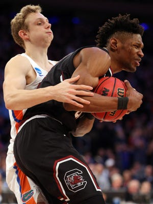 Florida guard Canyon Barry intentionally fouls South Carolina forward Chris Silva during the East Regional final in the 2017 NCAA Tournament at Madison Square Garden.