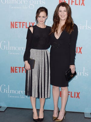 """Alexis Bledel, left, and Lauren Graham arrive for a fan event for a new revival season of the """"Gilmore Girls"""" television series at the Admiralspalast in Berlin, on Thursday, Nov. 10, 2016. The new TV mini series, entitled """"Gilmore Girls: A Year in the Life,"""" will be released on Netflix on Nov. 25, 2016."""
