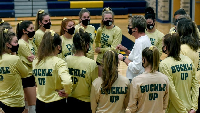 SMCC coach Karen O'Brien talks with her team as they wear their new warm up shirts to start their journey to Battle Creek at the Division 3 Districts held at Erie Mason on Nov. 2, 2020.