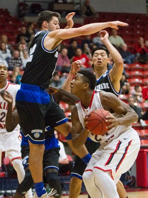 Dixie State guard Trevor Hill times a jump shot during their game against Chaminade University Tuesday, Jan. 5, 2016.