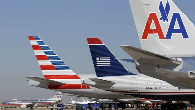 US Airways and American Airlines planes at DFW International Airport on Feb. 14, 2013.