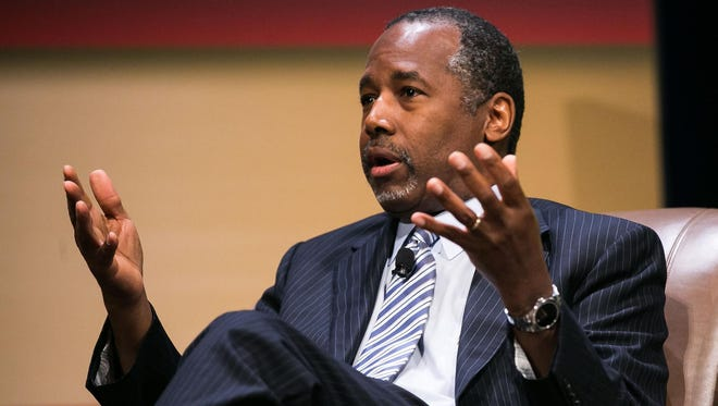 GOP presidential candidate Ben Carson speaks with Frank Luntz during the Family Leadership Summit in Ames on Saturday, July 18, 2015.