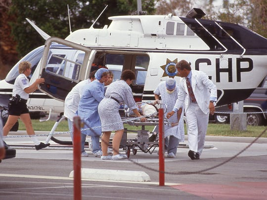 An injured Girl Scout arrives via CHP helicopter at Desert Hospital on July 31, 1991.