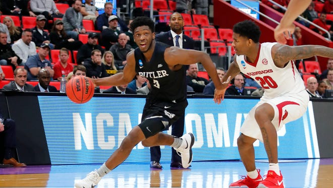 Butler forward Kelan Martin dribbles against Arkansas forward Darious Hall in the first round of the 2018 NCAA tournament at Little Caesars Arena.