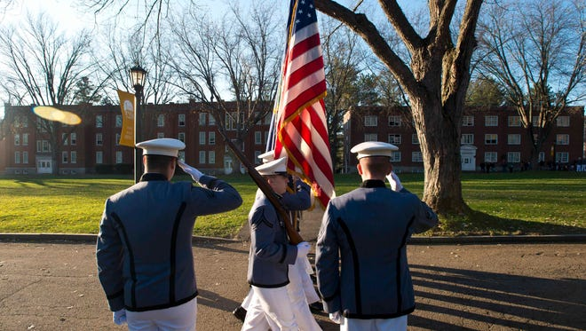 The Norwich University corps of cadets marches during Veterans Day observances in Northfield on Tuesday, November 11, 2014.