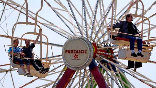 Fairgoers ride the Fairlift during the 150th Oregon State Fair, Tuesday, September 1, 2015, in Salem, Ore.