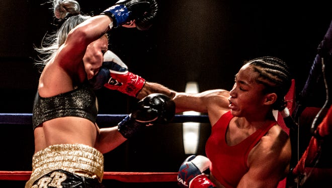 Alycia Baumgardner of Fremont lands a right cross on the face of her opponent, Britain Hart. The march bout was the first of Baumgardner's four professional boxing victories.
