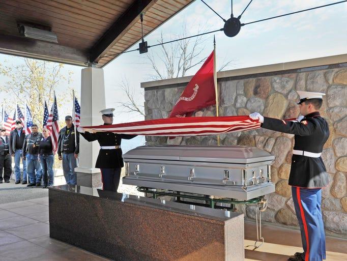 U.S. Marines Sgt. Alexander Brodie, left, and Cpl.