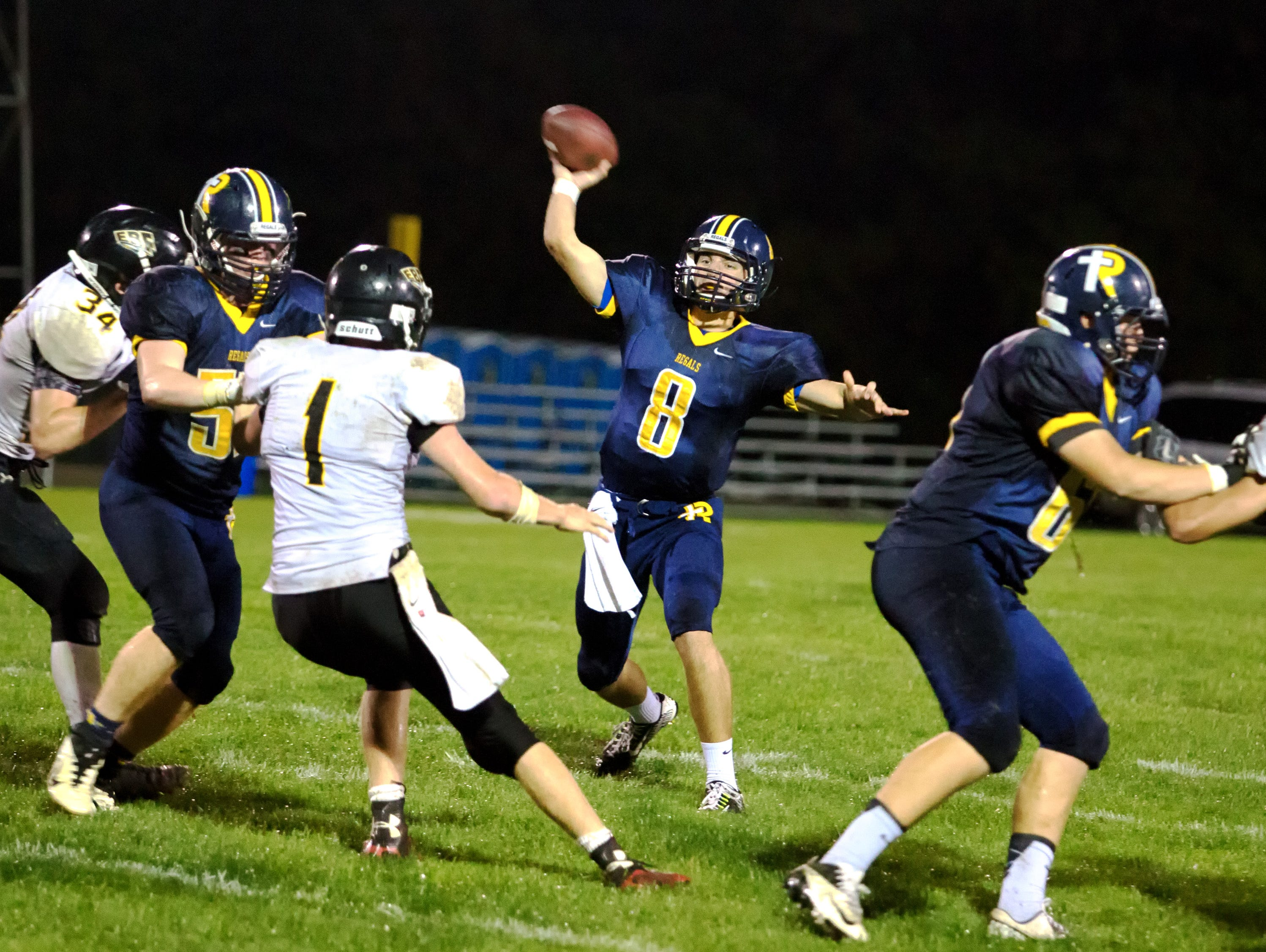 Iowa City Regina's Nathan Stenger (8) tosses a pass against Eddyville-Blakesburg-Fremont on Sept. 18. The Regals travel to Highland for a 7 p.m. matchup on Friday.