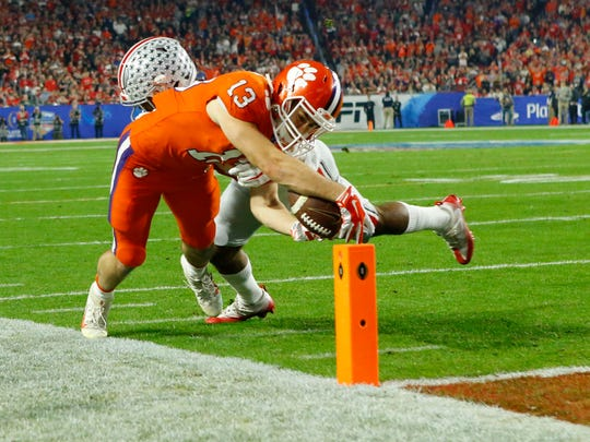 Ohio State Buckeyes cornerback Damon Arnette (3) knocks Clemson Tigers wide receiver Hunter Renfrow (13) out of bounds during the second quarter of the College Football Playoff Semifinal game in the PlayStation Fiesta Bowl on Dec. 31, 2016 at University of Phoenix Stadium in Glendale, Arizona.