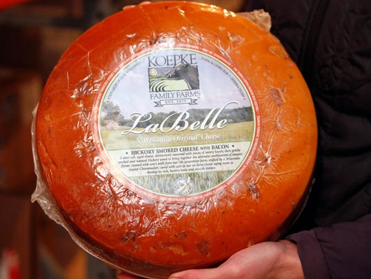 A wheel of LaBelle hickory smoked cheese with bacon