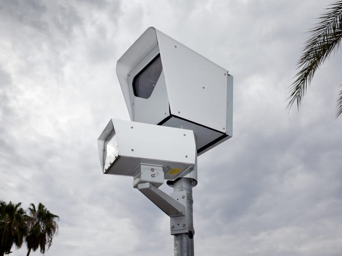 In Arizona, 11 cities and towns have red-light cameras,