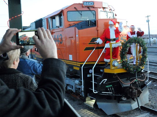 Santa and Mrs. Claus arrive at the Las Cruces Railroad Museum by train to visit with children during the museum's annual holiday event. This year's downtown festivities will include the city Christmas tree lighting, the Downtown Ramble, a holiday open mic and a new White Friday program with merchants staying open until 9 p.m.