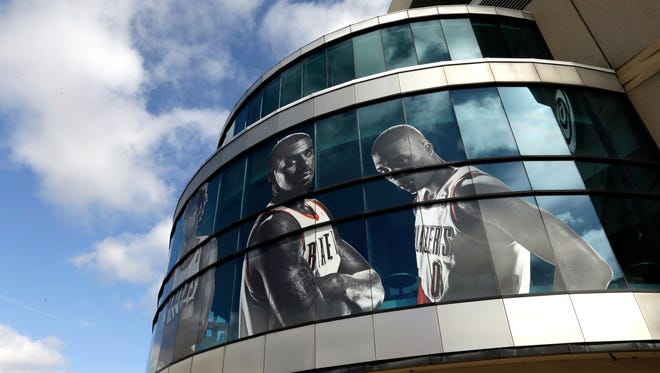 Likenesses of Portland Trail Blazers LaMarcus Aldridge, left, and Damian Lillard adorn the outside of the Moda Center arena in Portland, Ore., Wednesday, April 22, 2015.  The Trail Blazers, who play the Memphis Grizzies in Memphis tonight for Game 2 of their NBA first round playoff games, will return to the Moda Center Saturday for Game 3. (AP Photo/Don Ryan)