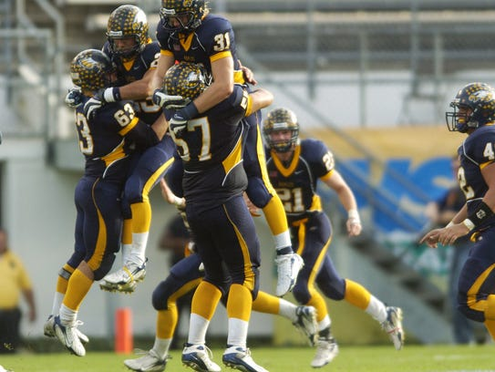 Naples players celebrate their 17-10 win over St. Augustine