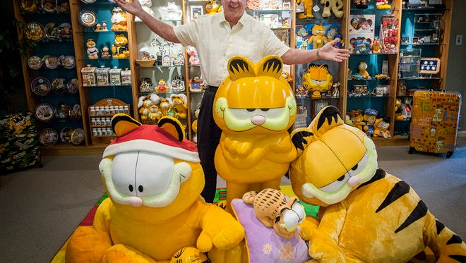 Jim Davis poses for a photo in the Garfield Library at Paws, Inc. in Albany.