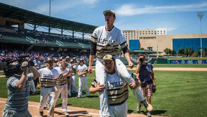 Brandon Vermillion celebrates Daleville's state championship over Lanesville at Victory Field Saturday, June 18, 2016.