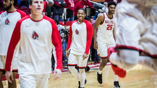 Ball State's Josh Thompson warms up with teammates before their game against Northern Illinois at Worthen Arena Friday, March 4, 2017.