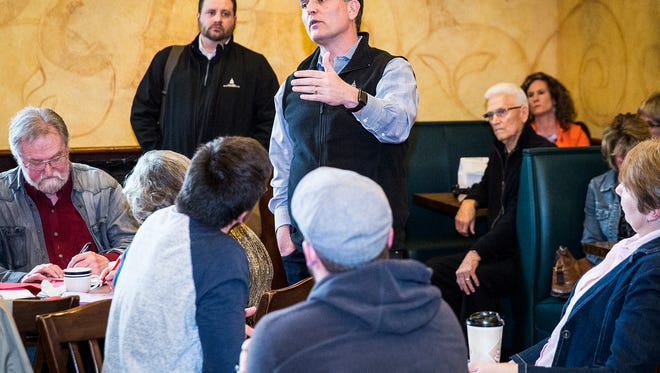 "Rep. Luke Messer answers questions from attendees during ""Coffee with the Congressman"" at Concannon's near McGalliard Road Friday afternoon."