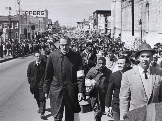 Marchers leaving Selma and approaching the Edmund Pettus Bridge where previous marchers were beaten.