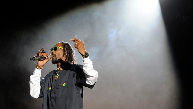 Snoop Dogg performs onstage during his headlining performance with Dr. Dre on the first weekend of the 2012 Coachella Valley Music and Arts Festival, Sunday, April 15, 2012, in Indio, Calif. (AP Photo/Chris Pizzello)