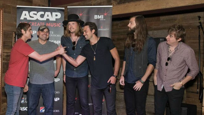 From left, Ross Copperman, Jon Nite, Michael Hobby, Zach Brown, Graham Deloach and Bill Satcher celebrate A Thousand Horses' first No. 1 song.