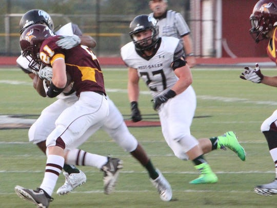 Forest Grove running back Caleb Camilli is tackled by West Salem cornerback Keonte McMurrin on Friday, Sept. 11, 2015.