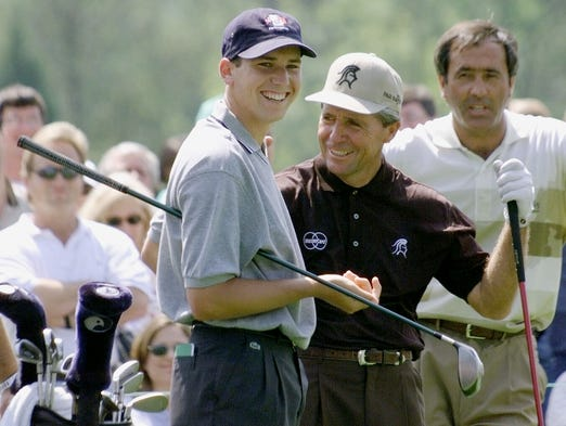 In a file photo from 1999, Sergio Garcia, left, laughs