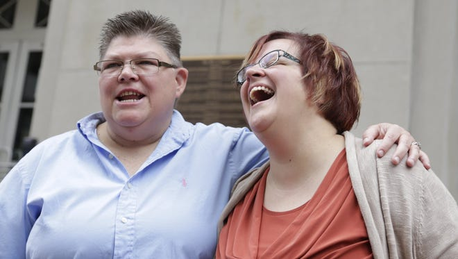 Jayne Rowse, left, and her partner, April DeBoer, make their way to the U.S 6th Circuit Court of Appeals in Cincinnati on Aug. 6, 2014.