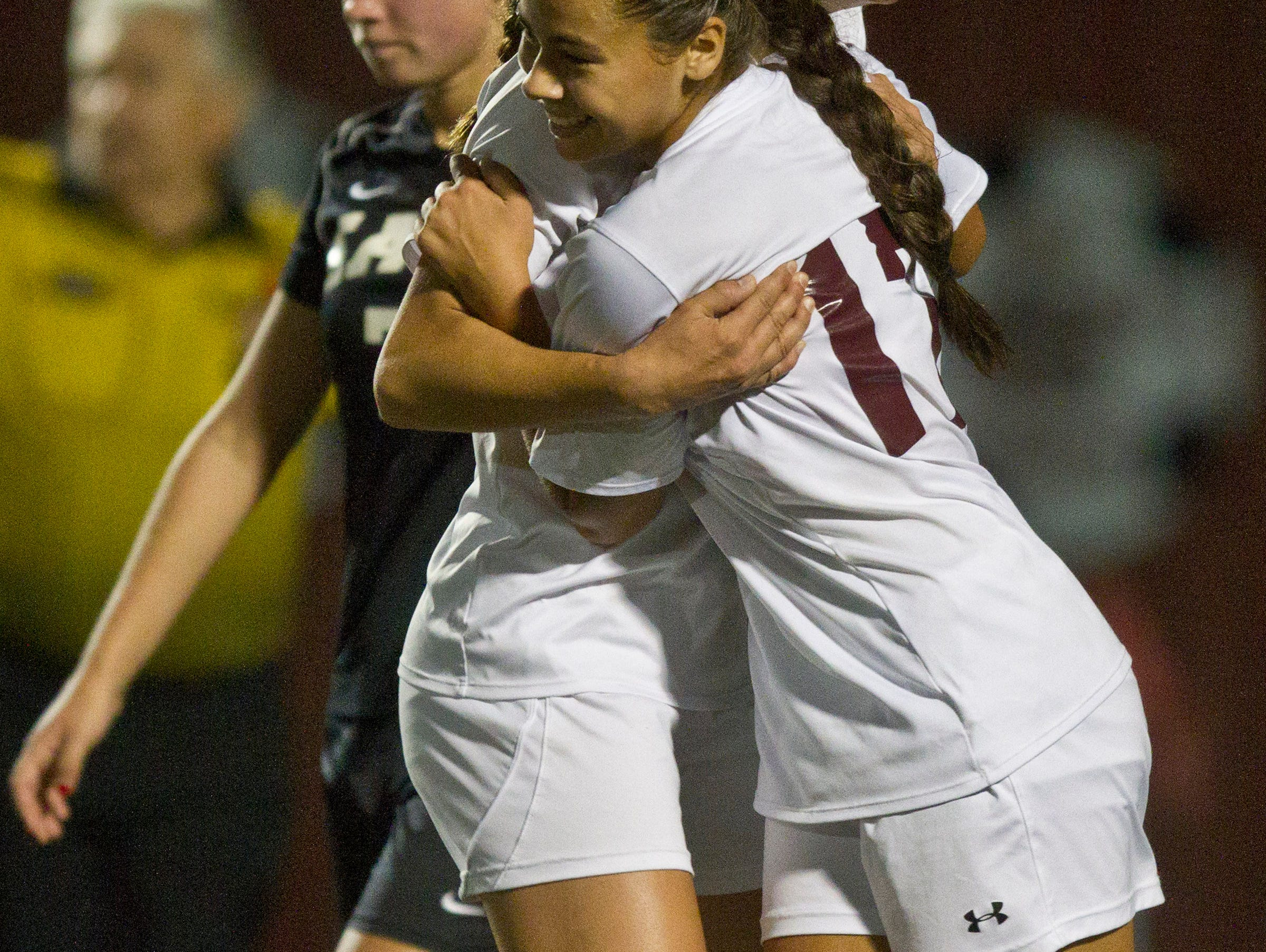 Toms River South's Aliya Canfield (17) celebrates with Charly Slavick after scoring a goal. Toms River East vs Toms River South soccer. Toms River, NJ Tuesday, October 13, 2015 @dhoodhood