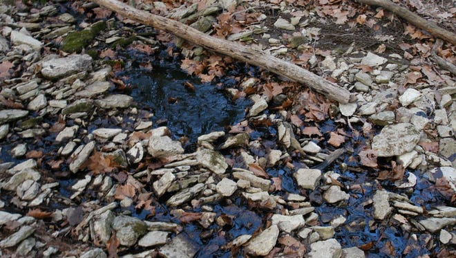 Crude oil discharges from a stream to a lake near the site of the spill.