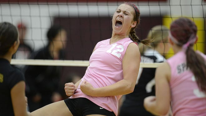 Luxemburg-Casco'??s Maggie Liebeck (12) screams with emotion after scoring a point against Oconto Falls during an Oct. 4, 2013, Bay Conference volleyball game at Luxemburg-Casco High School.