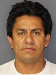 Lider Velez, 48, a village employee, was arrested and