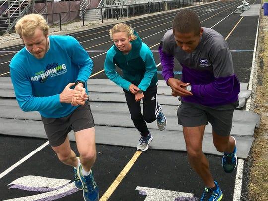 Emma Wilson (center) runs with coach Craig Jordan (right)