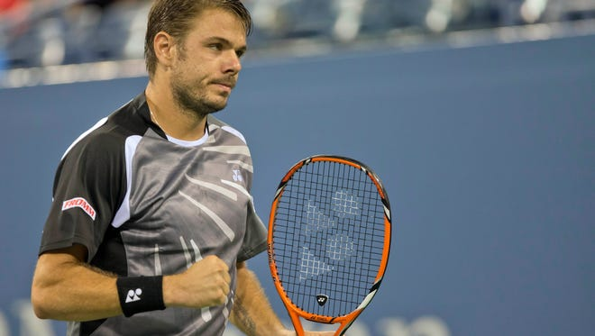 Stan Wawrinka reacts during his match against Thomaz Bellucci on day three of the 2014 U.S. Open. Wawrinka will advance to the 4th round after his opponent, Blaz Kavcic pulled out due to injury.