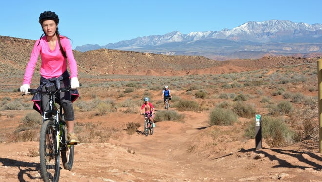 A St. George family bikes along the Bear Claw Poppy Trail on public lands managed by the BLM St. George Field Office.