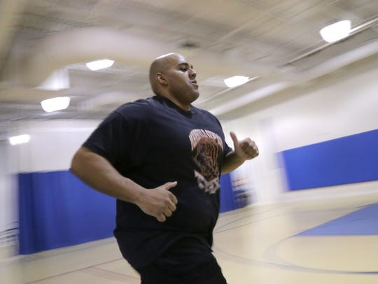 Mansfield Police Sgt. Toneli Webb does exercises Wednesday